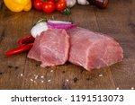 raw pork meat over wooden... | Shutterstock . vector #1191513073