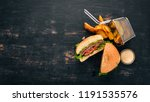 baked potatoes and burger with... | Shutterstock . vector #1191535576