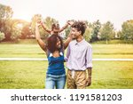 happy african family having fun ... | Shutterstock . vector #1191581203