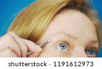 extreme close up. plucking...   Shutterstock . vector #1191612973