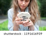 young girl with a phone | Shutterstock . vector #1191616939