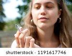 young girl smoking a cigarette | Shutterstock . vector #1191617746