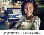 smiling young african waitress... | Shutterstock . vector #1191618880