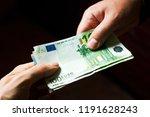 man giving a bribe | Shutterstock . vector #1191628243