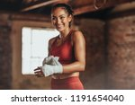 woman boxer wearing strap on... | Shutterstock . vector #1191654040