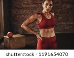 woman standing after workout at ... | Shutterstock . vector #1191654070