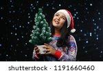 asian girl wearing christmas...   Shutterstock . vector #1191660460