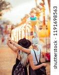 happy female friends in... | Shutterstock . vector #1191698563