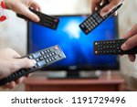 four people with tv controllers | Shutterstock . vector #1191729496
