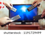 four people with tv controllers | Shutterstock . vector #1191729499