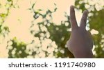 boy show two fingers with soft... | Shutterstock . vector #1191740980