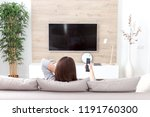 young woman watching tv in the... | Shutterstock . vector #1191760300