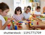 preschool teacher with children ... | Shutterstock . vector #1191771709