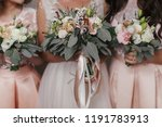 bridesmaids and bride holding... | Shutterstock . vector #1191783913