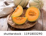 close up of cantaloupe melon on wooden table - stock photo