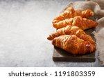 Fresh Croissants On Wooden...