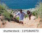 young couple hiking on the hill ... | Shutterstock . vector #1191864073