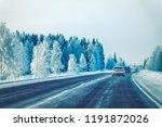 car in the winter road in... | Shutterstock . vector #1191872026