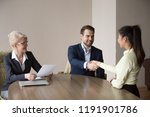 smiling recruiter shaking hand... | Shutterstock . vector #1191901786
