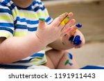closeup of toddler s hands... | Shutterstock . vector #1191911443