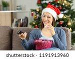 happy woman watching christmas... | Shutterstock . vector #1191913960