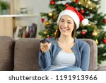 happy girl watching tv in... | Shutterstock . vector #1191913966