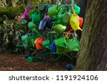 many watering cans on a cemetry ... | Shutterstock . vector #1191924106