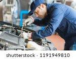 Auto Mechanic Working On A Car...