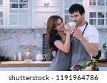 lovely couple in kitchen.... | Shutterstock . vector #1191964786