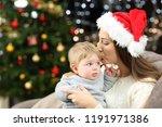 affectionate mother kissing her ... | Shutterstock . vector #1191971386