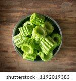 fresh bitter gourd or bitter... | Shutterstock . vector #1192019383