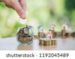 a men hand holding stacking... | Shutterstock . vector #1192045489