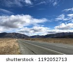 straight road leading to... | Shutterstock . vector #1192052713