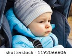 little child sitting in babies... | Shutterstock . vector #1192066606