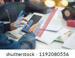 business hand working with new... | Shutterstock . vector #1192080556