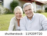 smiling senior couple sitting... | Shutterstock . vector #119209720