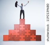 successful businessman standing ... | Shutterstock . vector #1192139680