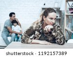 woman in camouflage drinks.... | Shutterstock . vector #1192157389