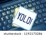 Small photo of Handwriting text writing Yolo. Concept meaning stand for You only live once popular phase among students and teens