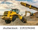 excavators and heavy machinery... | Shutterstock . vector #1192194340