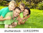 happy parents and children lie... | Shutterstock . vector #119223994
