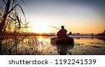 fishing. sunset on the lake. | Shutterstock . vector #1192241539