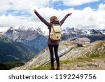 girl hiker looking at the... | Shutterstock . vector #1192249756