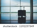 travel suitcases in empty... | Shutterstock . vector #1192257349