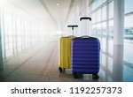 two suitcases in empty airport... | Shutterstock . vector #1192257373