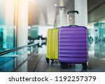 two suitcases in airport... | Shutterstock . vector #1192257379