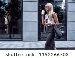 young stylish woman walking on... | Shutterstock . vector #1192266703