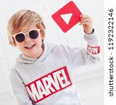 Small photo of Ukraine- September 30, 2018: Portrait of cute happy boy, kid with marvel logo and youtube play icon
