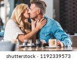 affectionate boyfriend and... | Shutterstock . vector #1192339573
