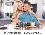 attractive girlfriend hugging... | Shutterstock . vector #1192339660